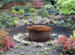 "Round steel fountain: 48"" diameter x 40""h with steel retaining wall"