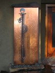"Totem: Copper, stone, reclaimed steel. 33""w x 91""h x 4""d"