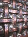 Weave closeup. Micro-hammer embossed copper with patina